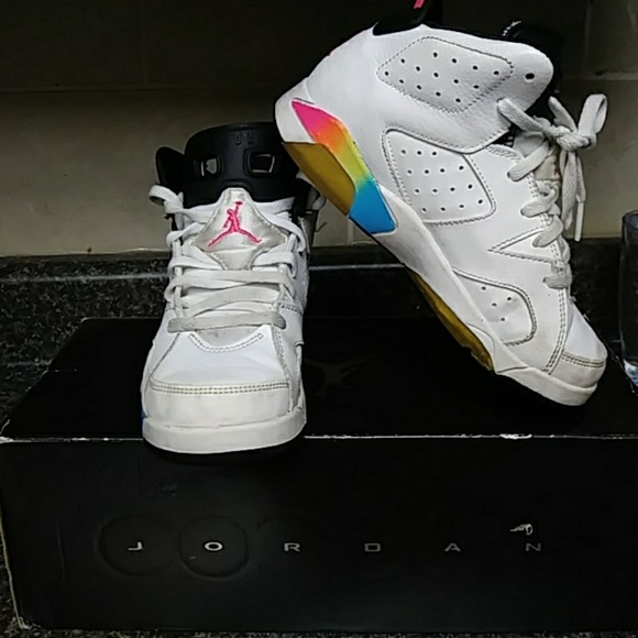 white and rainbow jordans